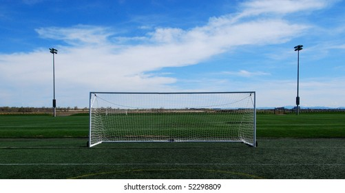 Empty Soccer Goal and a Beautiful Blue Sky.  Plenty of room for your ad copy.