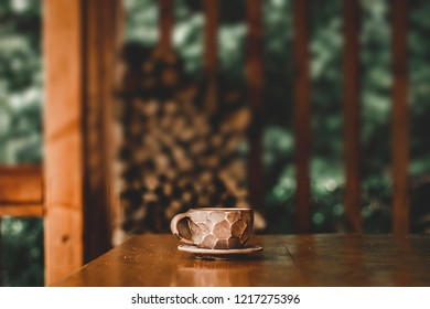 Empty space for an advertising product. One cup on a wooden table. Copy space
