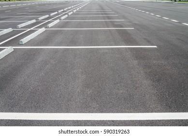 Empty space in outdoor asphalt parking lot