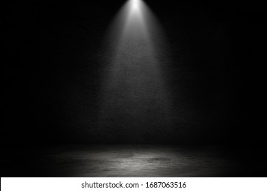 Empty space of Studio dark room black concrete wall and spotlight with concrete floor for showing product.