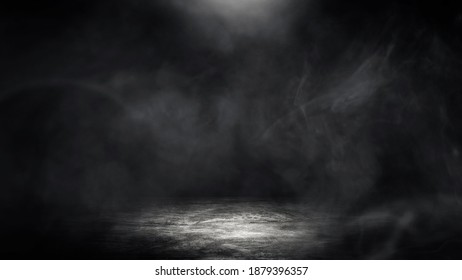 Empty space studio dark room of Concrete floor grunge texture background with spot lighting and fog or smoke in black background.