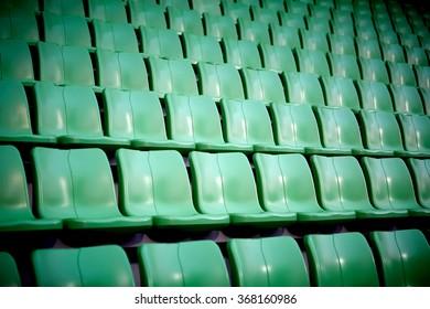 empty sport stadium chairs background