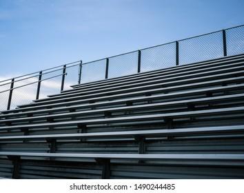 Empty Sports Stadium Bleachers  Blue Sky