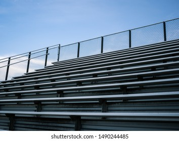 Empty Sports Stadium Metal Bleachers  Blue Sky