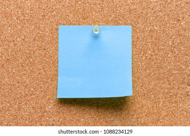 empty square blue pinned sheet on a brown cork reminder