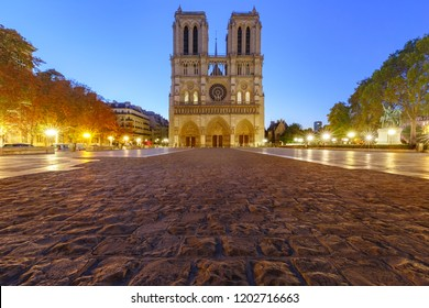 Empty square and Cathedral of Notre Dame de Paris in the morning, Paris, France