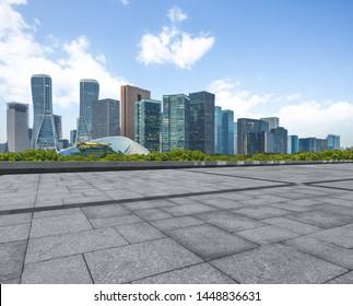 empty square and city skyline under blue sky, hangzhou city, china.