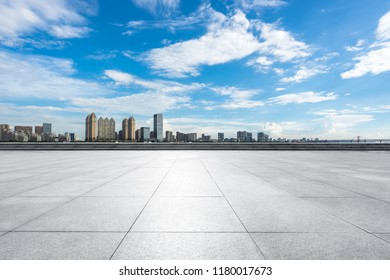 empty square with city skyline in wuhan china