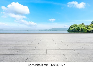 Empty square floor and beautiful mountain with lake
