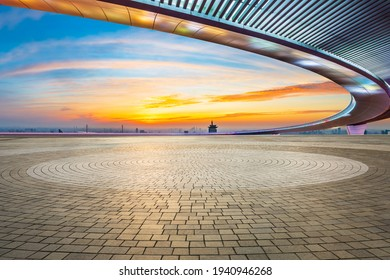 Empty square floor and city skyline at sunset in Shanghai.