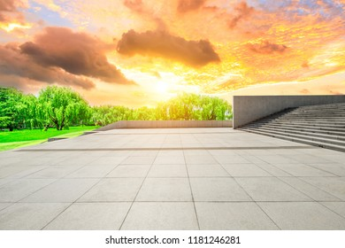 Empty square floor and green forest natural scenery at sunset