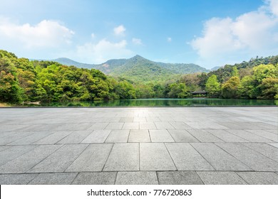 empty square floor and green mountain nature landscape in city park