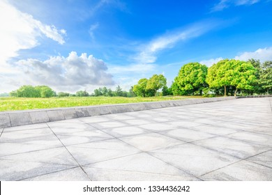Empty square floor and green woods in nature park