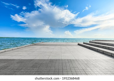Empty square floor and lake landscape under the blue sky.