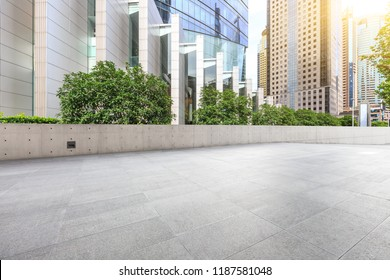 Empty square floor and modern city commercial building scenery