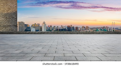 Empty square floor and Shanghai skyline with buildings at dusk,China.High angle view. - Shutterstock ID 1938618490