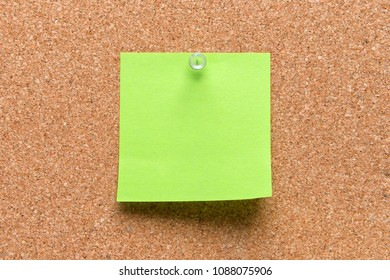 empty square green pinned sheet on a brown cork reminder