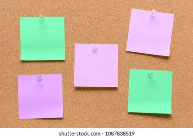empty square green and purple pinned sheet on a brown cork reminder