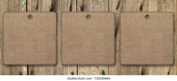 Empty square shapes hanging up on a wood surface