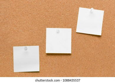 empty square white pinned sheet on a brown cork reminder