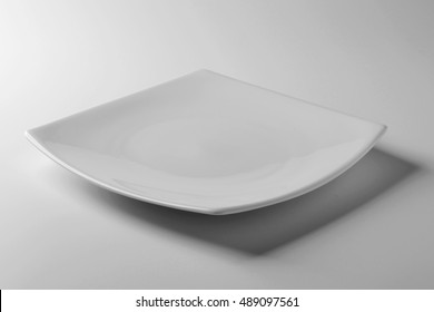 Empty Square white plate on white table