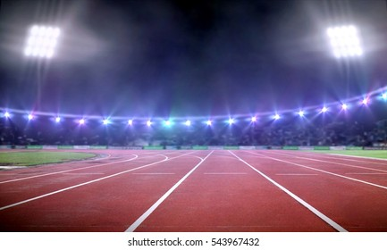 Empty stadium with running track under spotlight at night