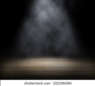 An empty stage, lit by spotlight