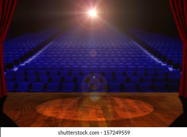 Empty Stage and Empty Seats with Bright Spotlight
