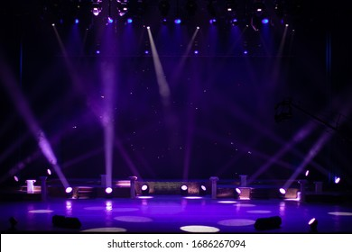 An empty stage of the theater, lit by spotlights and smoke before the performance - Shutterstock ID 1686267094