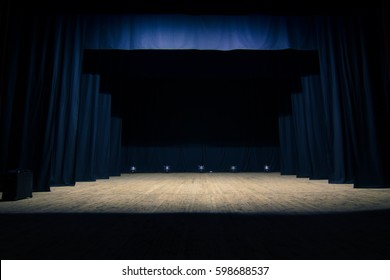 An empty stage of the theater, lit by spotlights before the performance