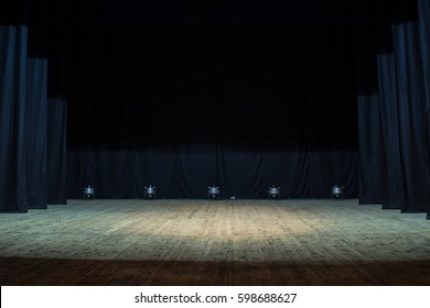 An Empty Stage Of The Theater Lit By Spotlights Before Performance