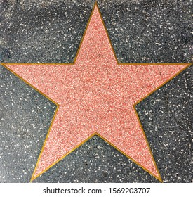 An empty star in the Walk of Fame sidewalk in Hollywood.