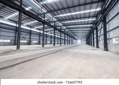 empty steel structure workshop, abandoned factory buildings or warehouse