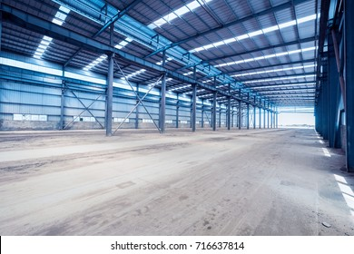 empty steel structure workshop, interior of abandoned factory buildings or warehouse background