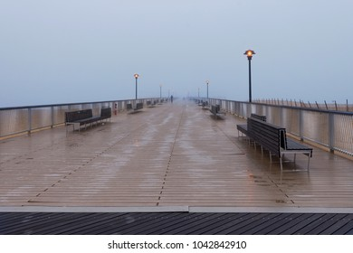 Empty Steeplechase Pier on Coney Island Beach in New York City on a rainy, winter day.