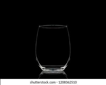 Empty stemless wine glass on black