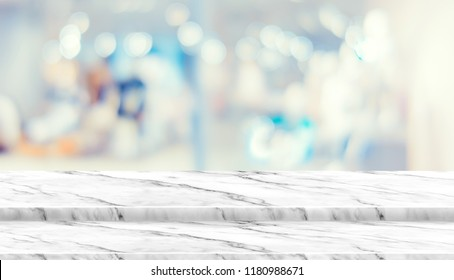 Empty step marble table top food stand with blur department store background bokeh light,Mock up for display or montage of product,Banner for advertise on online media,business presentation