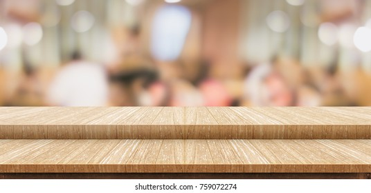 Empty step wood table top ( food stand ) with blur customer dining at cafe restaurant background bokeh light,Mock up for display or montage of product,Banner for advertising online media
