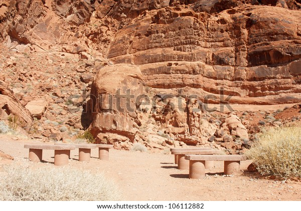 Empty stone benches for show in red rock canyon