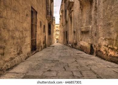 Empty stone narrow street in the capital of malta - Valletta