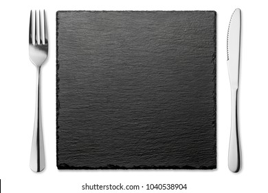 Empty stone plate with knife and fork isolated on white background, Top view.