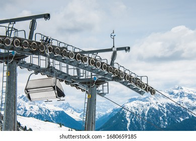 Empty stopped chair lift due to coronavirus pandemic restrictions with winter view over majestic Alps mountains and valleys on Italian Austrian border, near Cavalese, Val di Fiemme, Trentino, Italy