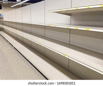 Empty store shelves as Coronavirus pandemic drives people to hoard paper products.