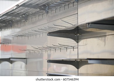 empty store shelves in super market, lighting fixtures and shelves for sale product