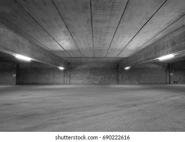 Empty Storehouse Interior for Background. Abandoned Parking Lot. Black and White Look.
