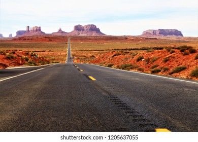 Empty Straight Road in Arid Desert of the American Wild West - Death Valley National Park, Monument Valley in Arizona, USA