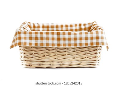 Empty straw basket with checkered brown linen isolated.