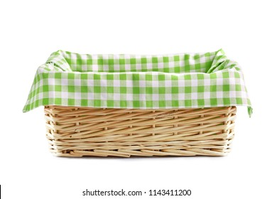 Empty straw basket with checkered linen isolated.