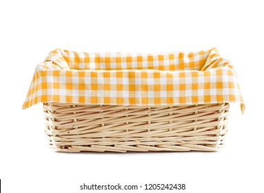 Empty straw basket with checkered yellow linen isolated.