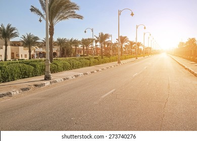 empty street, an empty city at sunset